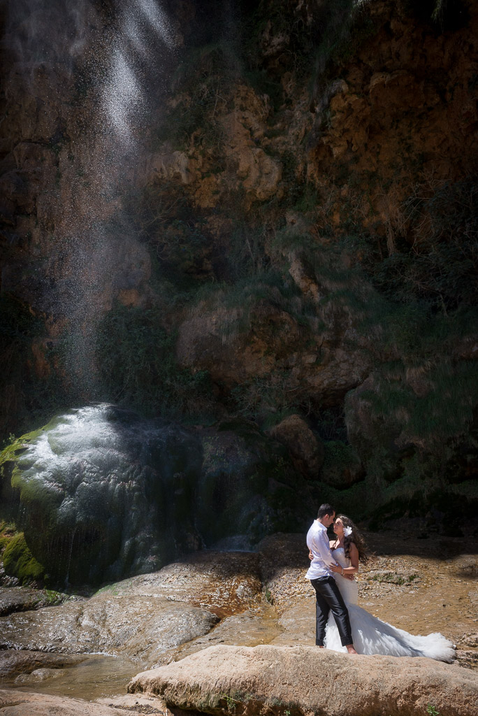 A young couple getting a photo session at the Bridal Veil waterfall during the hot springs tour